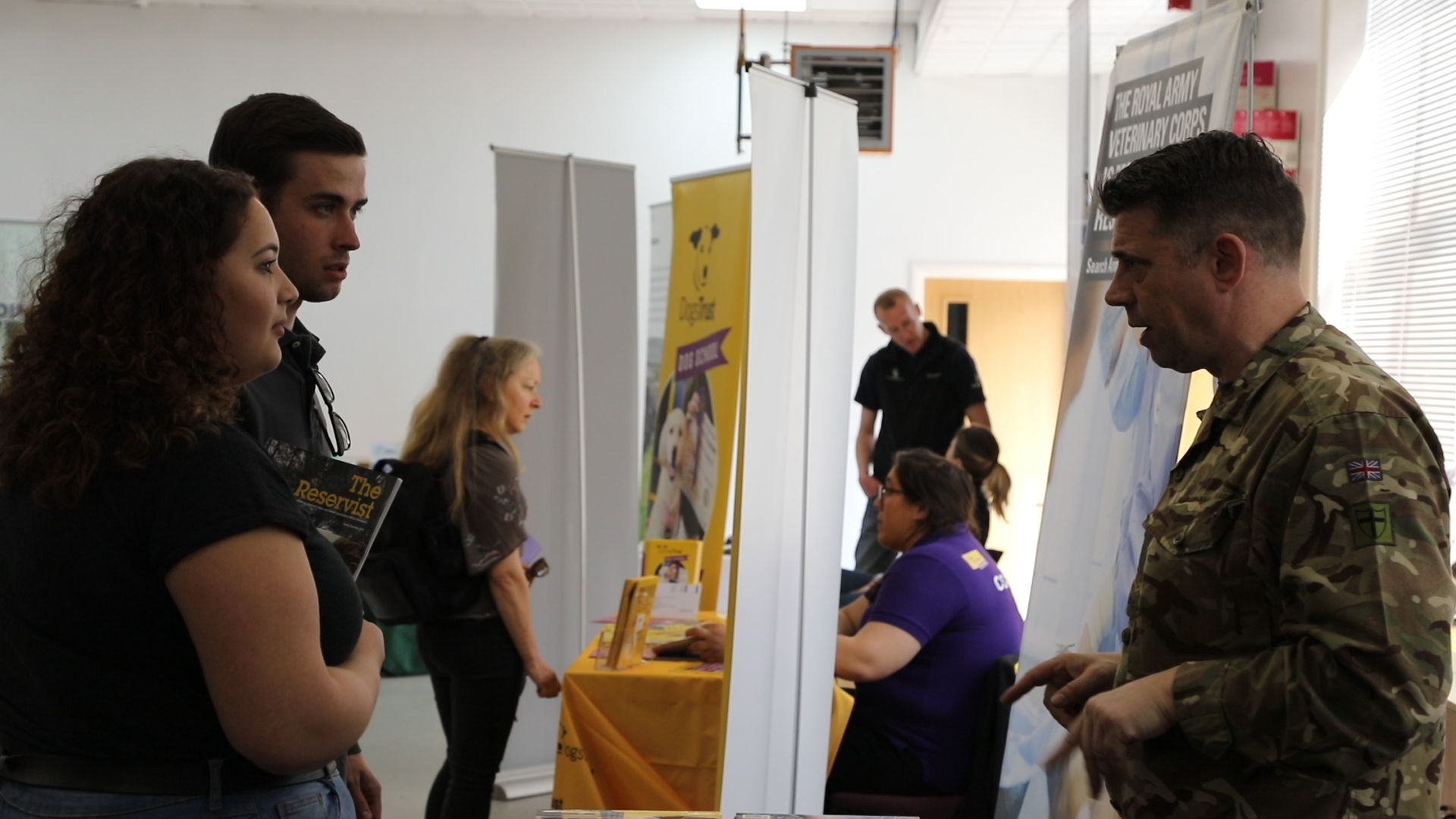 Visitors at Careers With Animals Day speaking to an exhibitor